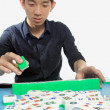 Stock Photo: Chinese man play Mahjong, traditional China gamble.
