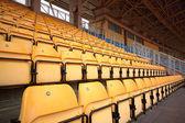 Plenty of yellow plastic seats at stadium — Stock Photo