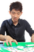 Chinese man play Mahjong, traditional China gamble. — Stock Photo