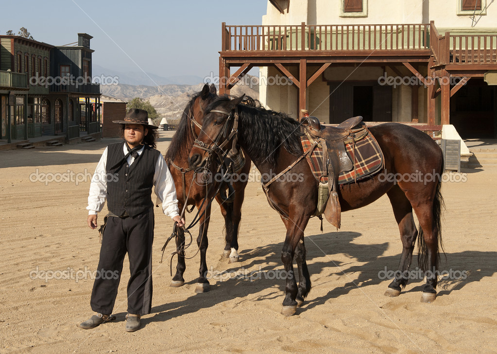 Cowboy Sheriff holding two horses at Mini Hollywood, Tabernas, Almeria Province, Andalusia, Spain — Stock Photo #9533679