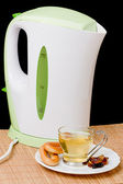 Kettle and a cup of tea — Stock Photo