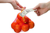 Buying orange mesh — Stock Photo