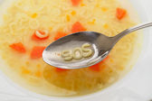 Alphabet letters in spoon — Stock Photo