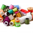 Stock Photo: Heap bobbins of sewing threads