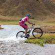 Cyclist at the speed of moving mountain river — Stock Photo #10164721