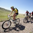 Adventure mountain bike marathon in desert - Stock Photo