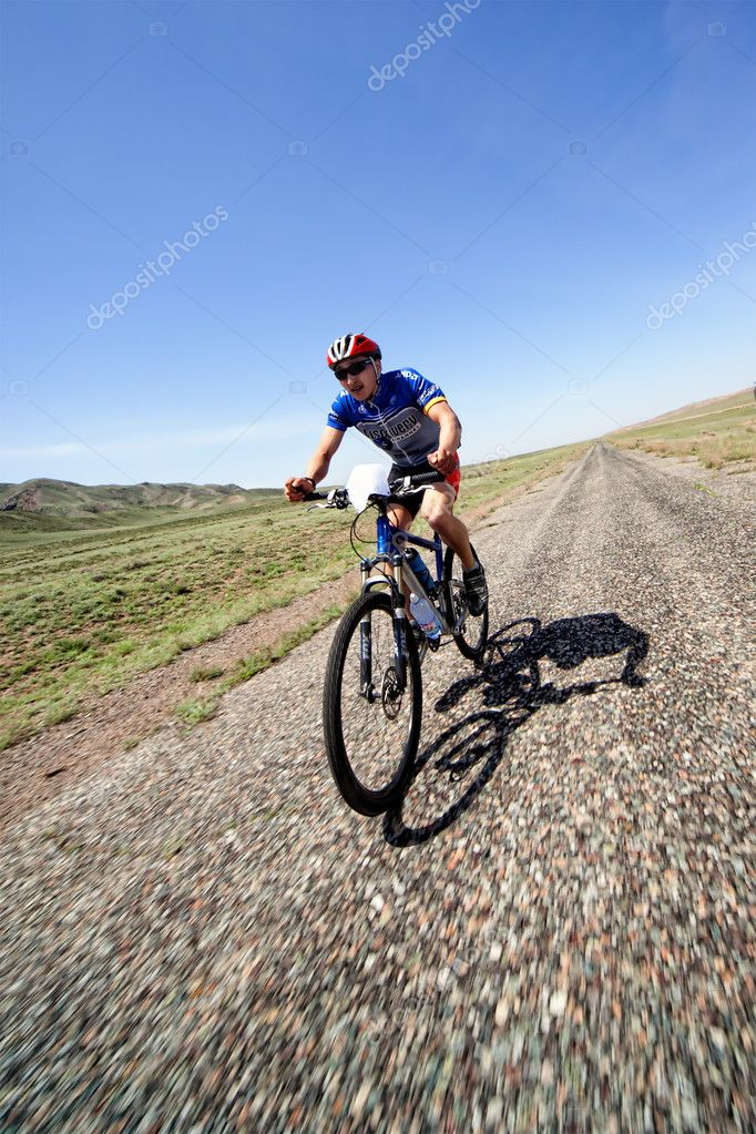 "ALMATY, KAZAKHSTAN - May 1: Janibek Satkynaliev in action at Adventure mountain bike cross-country marathon in desert ""Jeyran Trophy 09"" in Almaty, Kazakhstan May 1, 2009. — Stock Photo #10164834"