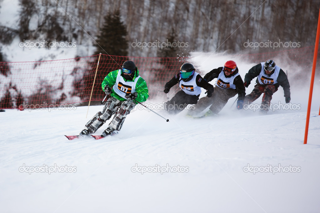 ALMATY, KAZAKHSTAN - January 8: Alexandr Dyadchik (N07) in action at Ski and Boarder Cross competition on Ski Resort Akbulak, January 8, 2011 in Almaty, Kazakhstan. — Stock Photo #10164926