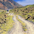 Desert mountain road in Mongolia - Stock Photo