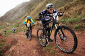 Hard bike competition in mountains — Stock Photo