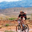 Adventure mountain bike  marathon in desert — Stock Photo