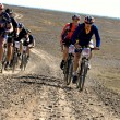 Adventure mountain bike marathon in desert — Stock Photo #9175869