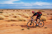 Adventure mountain bike marathon in desert — Stock Photo