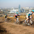 Mountain bike competition on rural road in megapolis - Stock Photo