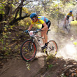 Mountain bike competition in autumn forest — Stock Photo
