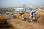 Mountain bike competition on rural road in megapolis — Stock Photo