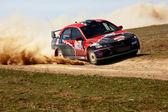 Auto rally in spring desert — Stock Photo