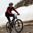 Mountain bike and runnig competiton — Stock Photo #9192003