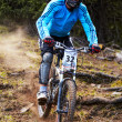 Mountain biker on downhill rce - Stock Photo