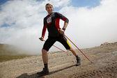 Mountain bike and runnig competiton — Stock Photo