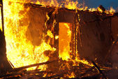 Fire in an abandoned house — Stock Photo