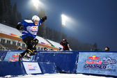 Competitors race at the Redbull Crashed Ice, Ice cross — Stock Photo