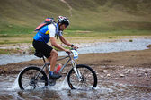 Adventure mountain bike competition — Stock Photo