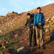 Stock Photo: Two backpackers in mountains