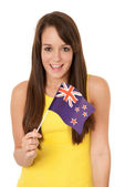Woman waving New Zealand flag — Stock Photo