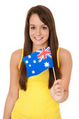 Woman waving Australian flag — Stock Photo