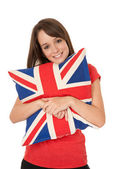 Woman cuddling Union Jack pillow — Stock Photo