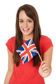 Woman waving Great Britain flag — Stockfoto