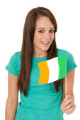 Woman waving the Irish flag — Stock Photo