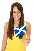 Woman waving the Scottish flag — Stock Photo