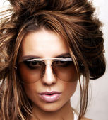 Sexy girl brunette wearin sun glasses — Stock Photo