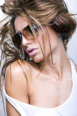 Woman with sunglasses and beautiful hair — Stock Photo