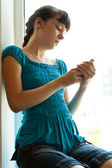 Girl with a phone — Stock Photo