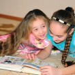 Two girls read book — Foto Stock #8934005