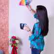 Girl Choosing a Color for the Walls — Stock Photo