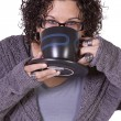 Stock Photo: Woman Drinking Coffee Standing Up