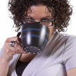 Woman Drinking Coffee Standing Up — Stock Photo #9526394
