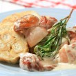 Porcini mushrooms in cream sauce and dumplings - Stock Photo