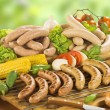 Grilling sausages — Stock Photo