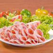 Slices of Mortadella salami — Stock Photo