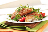 Fried fish and fresh salad — Stock Photo