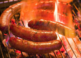 Grilling bratwursts — Stock Photo