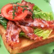Toast with crispy bacon strips — Stockfoto
