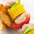 Shish kebab and potato wedges — Stock Photo #8126304