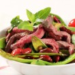 Vegetable salad with strips of beef - Stock Photo