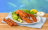 Lobster and vegetable garnish — Stock Photo